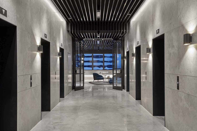 minimal commercial tower elevator hall lighting